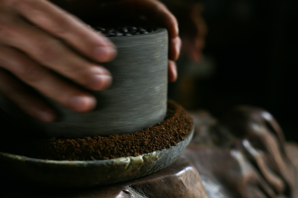 An old traditional coffee grinder being used in Hainan, China