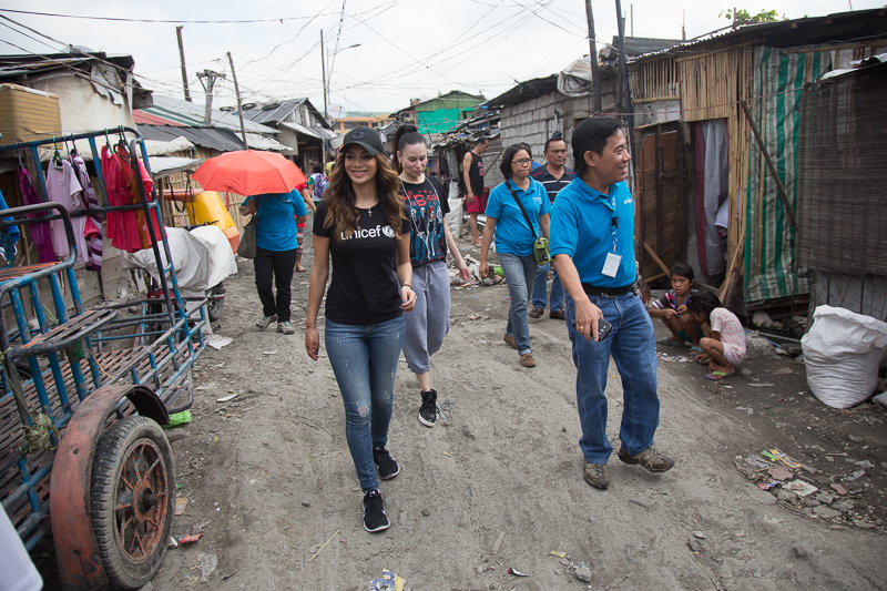 Nicole and UNICEF staff walking through Baseco Compound