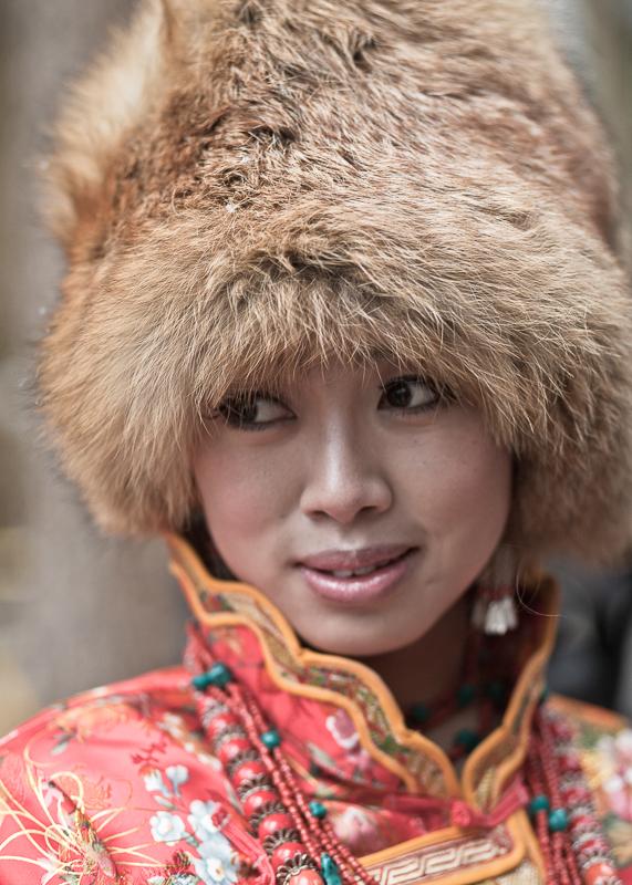 Young lady in traditional dress, Jiuzhaigou