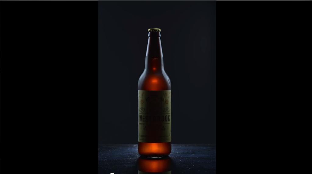 Fourth light right of bottle